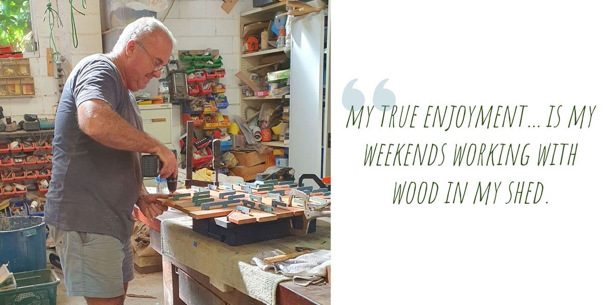 Ric at work with the drill in his shed; 'My true enjoyment… is my weekends working with wood in my shed.'