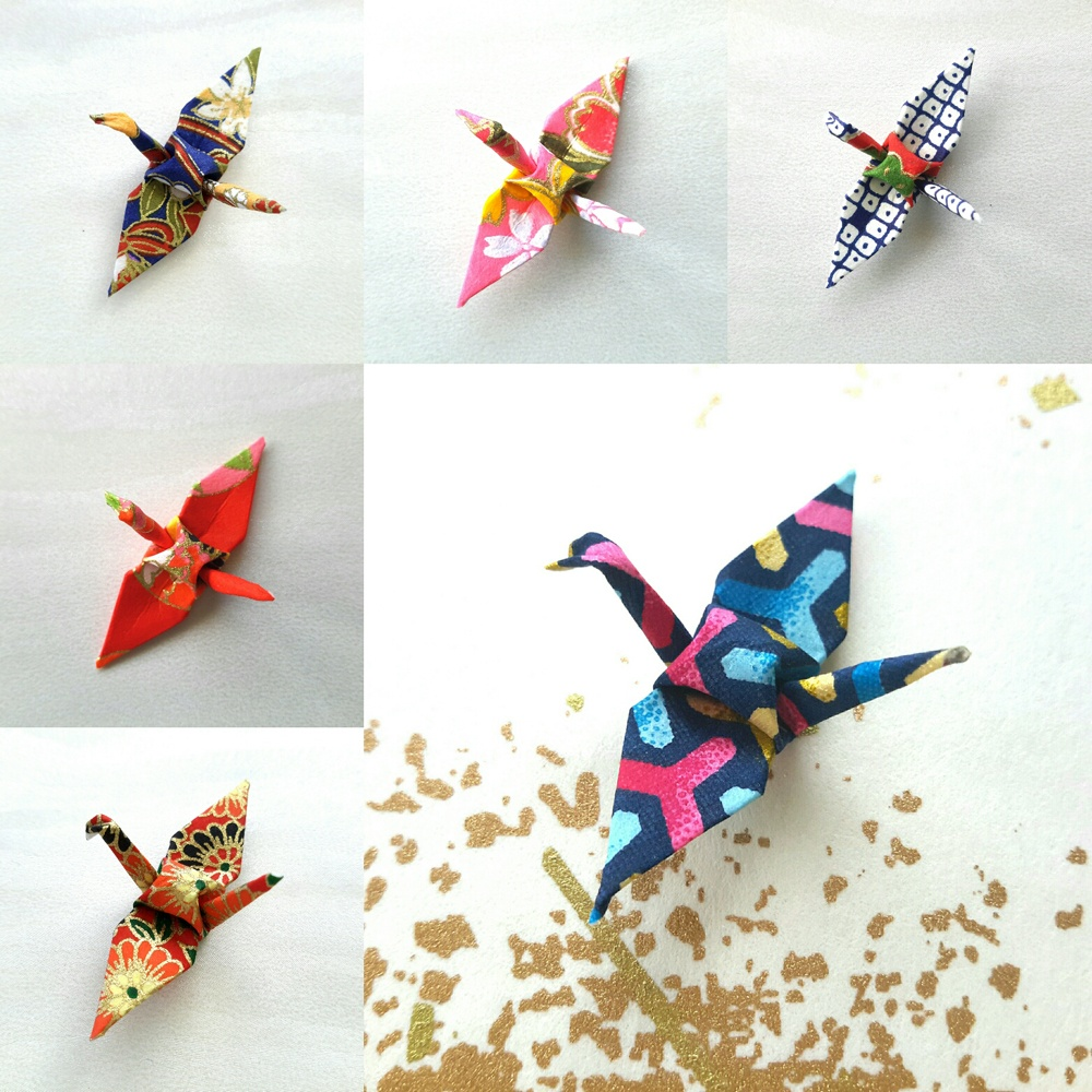 A grid of photographs of individual small-scale origami cranes made from colourful papers