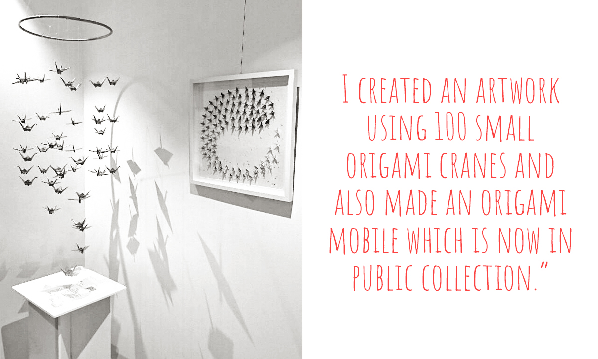 Marion's Paper crane mobile and one of her first miniature paper crane art works hanging in a public gallery: 'I created an artwork using 100 small origami cranes and also made an origami mobile which is now in public collection.'