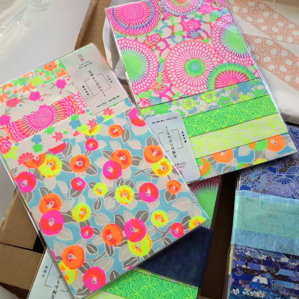 Packs of very bright fluro coloured origami papers from Japan