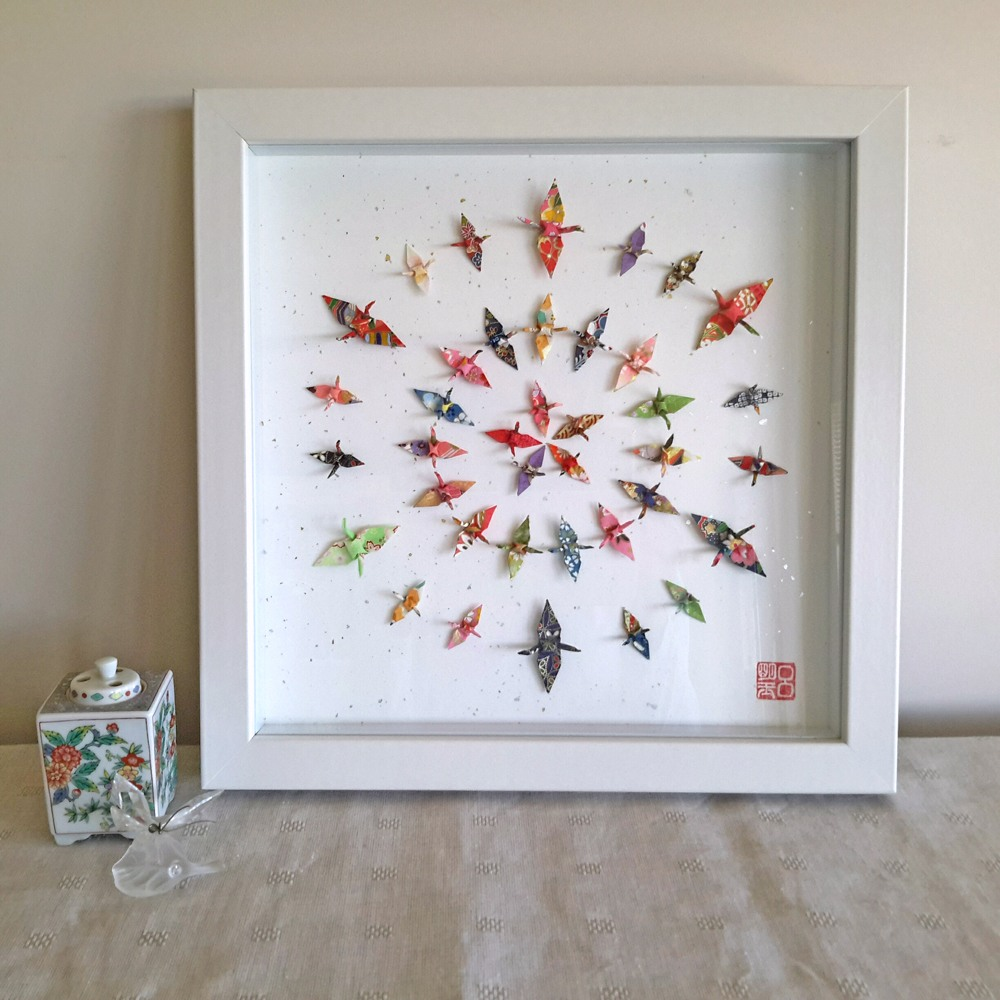 Framed origami artwork by Wish Upon A Wing featuring circles of very small scale folded paper cranes