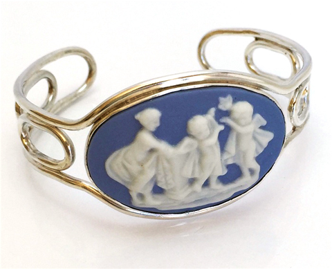 Blue and white vintage china set in a sterling silver cuff.